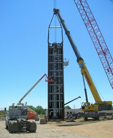 Second ASU cold box module raised to vertical.  Being inspected prior to lift from ground.