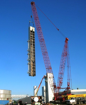 Third ASU cold box module being swung into position. Module has been rotated, showing open side.
