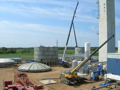 Overview of compressor building, molecular sieve unit, cold boxes, and liquid storage tanks under construction in New Carlisle, IN.